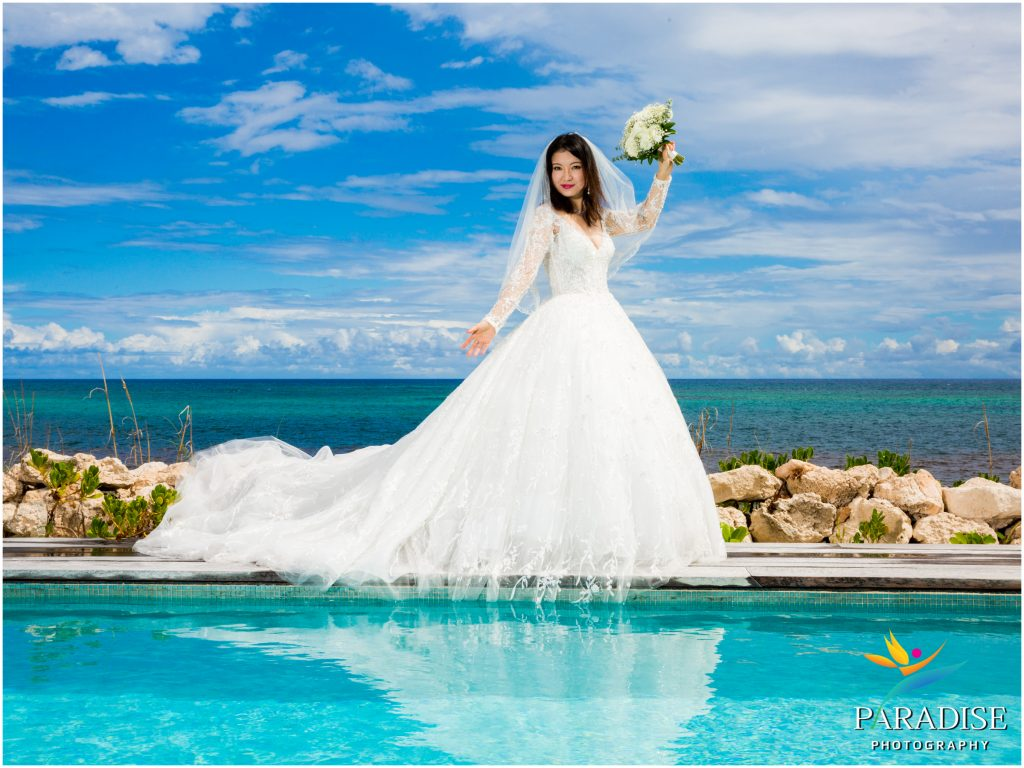 ee0db988bd ... to your beach wedding. If you're asking us for our advice, we say go  for it! Voluminous multi layered gowns against the turquoise waters and  tropical ...